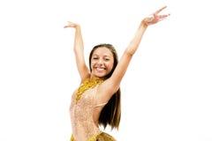 Teenger ono uśmiecha się w złotej sukni Obraz Stock