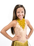Teenger que sorri no vestido dourado Fotografia de Stock Royalty Free