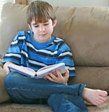 Teenger Reading. Teenage Boy Sitting Reading a Good Book Stock Images