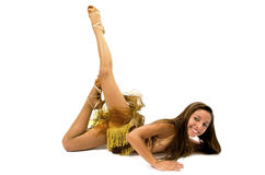 Teenger smiling in golden dress. Posing for dancing Royalty Free Stock Photo