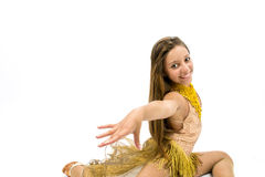 Teenger smiling in golden dress. Posing for dancing Royalty Free Stock Images