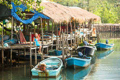 Teengirl in a fishing village. Travel. Stock Photo
