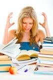 Teengirl frustrado con los libros cansados de estudiar Imágenes de archivo libres de regalías