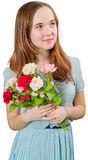 Teengirl hermoso en vestido azul con el ramo de flores Imagen de archivo libre de regalías