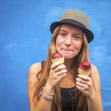 Teengirl with ice cream, blue wall background (Instagram style series) Stock Photo