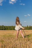 Teengirl with a scythe at summer field Royalty Free Stock Photography