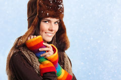 Teennager girl smiling on winter snow background Royalty Free Stock Images