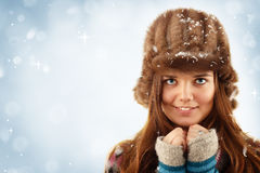 Teennager girl on winter blue background Stock Image