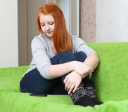 Teenr girl waits phone call. After quarrel at home Royalty Free Stock Photos