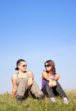 Teens. Cute teens relaxing on the grass Stock Image
