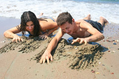 Teens. Creeping from the sea Stock Photo