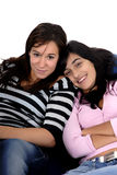 Teens. Two young casual girls portrait in studio Stock Images