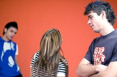 Teens. Three teens posed on an orange background royalty free stock image