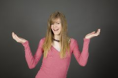 Teens. Preteen girl posing on gray background with some attitude Stock Photography