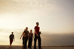 Teens. Going people on the sunset background Stock Photo