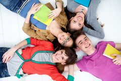 Teens. Group of teenage friends look up at the camera with bright smiles Royalty Free Stock Images