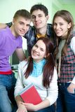 Teens. Portrait of four  friendly  teens in classroom Stock Photography