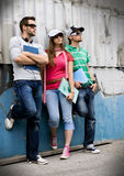 Teens 5. Three students standing in front of a graffiti-wall Royalty Free Stock Image