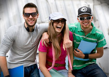 Teens 6. Three students standing in front of a graffiti-wall Royalty Free Stock Image