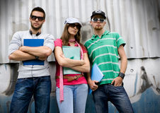 Teens 7. Three students standing in front of a graffiti-wall Stock Images
