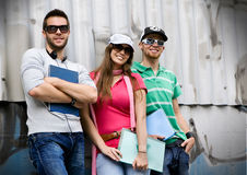 Teens 8. Three students standing in front of a graffiti-wall Stock Image