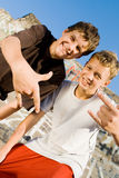 Teens. Two teens boys giving hand signs Stock Photography