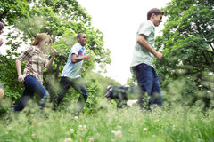 Teens active in park Royalty Free Stock Image