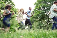 Teens active in park Stock Photo
