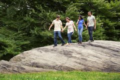 Teens active in park Stock Photography