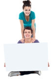 Teens advertising white blank billboard Stock Photography