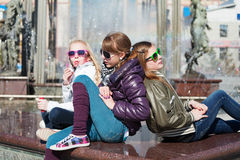 Teen girls against a city fountain Stock Photo