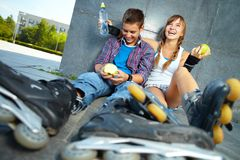 Teens with apples. Couple of two happy teens with apples sitting outside Royalty Free Stock Photography