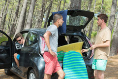Teens arriving at beach by car Royalty Free Stock Image