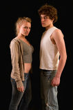 Teens with attitude. Portrait of two teens (actually brother and sister) looking tough Stock Images