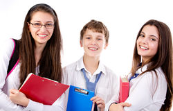Teens back to school. Group of happy students  standing  on white background Stock Photography