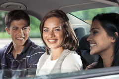 Teens in backseat of car Stock Images