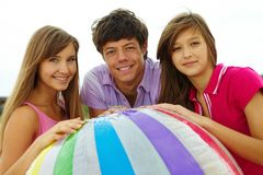 Teens with ball Stock Photo