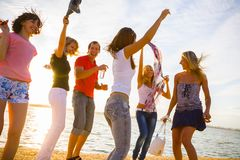 Teens beach party royalty free stock photo