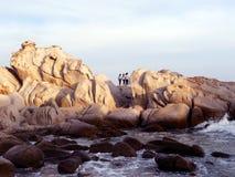 Teens on the beach Rocks hill Stock Photo