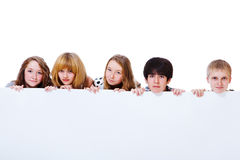 Teens behind poster Stock Images