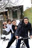 Teens on bicycle in winter season Royalty Free Stock Photo