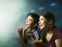 Teens boy and girl watching horror movie film Royalty Free Stock Images