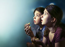 Teens boy and girl watching horror movie film. With pop corn blood splash Royalty Free Stock Photos