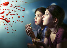 Teens boy and girl watching horror movie film Stock Photo