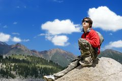 Teens boy in mountains hike. In summer vacations, Tien Shan Royalty Free Stock Image