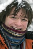 Teens boy in scarf  outdoors in winter. Pretty  European teens boyscarf are laughing outdoors in winter Royalty Free Stock Photography