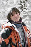 Teens boy in scarf  outdoors in winter. Pretty  European teens boy in scarf are laughing outdoors in winter Royalty Free Stock Photography