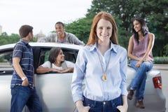 Teens with car Royalty Free Stock Photos