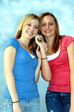 Teens on cell phone Stock Images