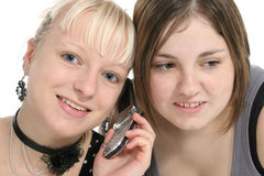 Teens on Cellphone. Teen girls on cellphone together Stock Image